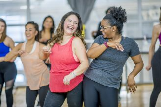 Group of women working out together at a dance fitness classogether at a fit