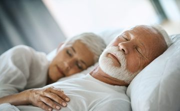 white haired couple sleeping soundly