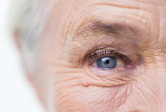 closer up of an older woman's right eye which is blue