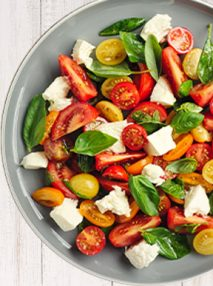 mixed tomato salad with basil and ripped mozzarella