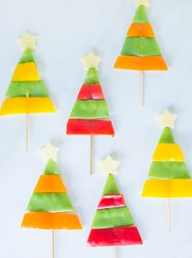 six individual savoury christmas trees made out ofsnow peas and capsicum