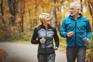 man and woman going for a brisk walk outdoors