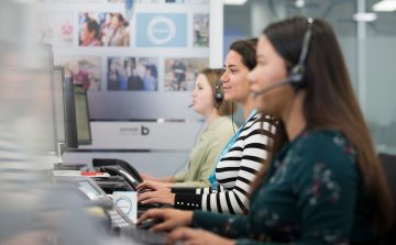 profile shot of three telephonists in a call centre